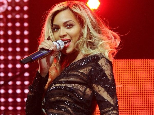 GLAM SLAM: Beyonce's Roberto Cavalli Spring 2014 Sheer-Paneled Gown at the DirecTV Super Bowl Concert