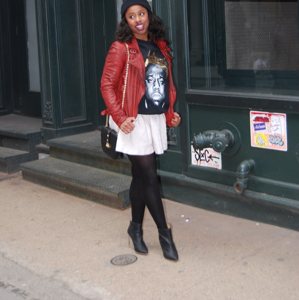 black woman in white mini skirt biggie smalls tee shirt red leather jacket black purse long hair black stockings black leather pumps stylish diva