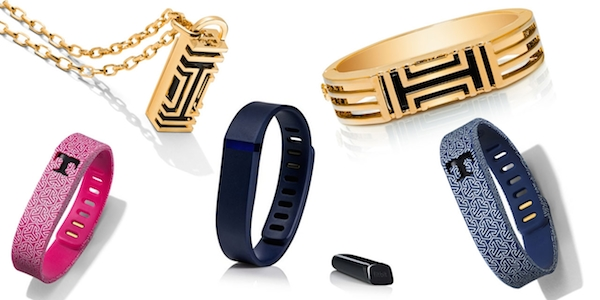 141755a7b07 tory-burch-fitbit. It includes a gold and black metal hinged bracelet ...